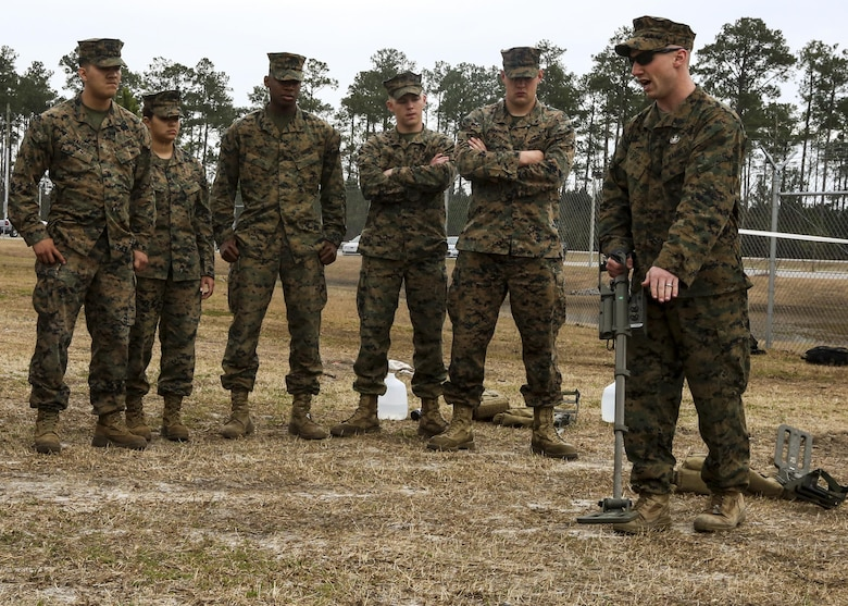 Sgt. Dereck Ford, a technician with Explosive Ordnance Disposal Company, teaches Marines with Combat Logistics Battalion 2 how to power up and recalibrate a metal detector during an improvised explosive device training exercise at Camp Lejeune, N.C., Feb. 23, 2016. CLB-2 Marines learned how to recognize signs of a buried IED and use the detector to identify the type of IED as they conducted hands-on training in preparation for their upcoming deployment with Special Purpose Marine Air Ground Task Force Crisis Response Africa. (U.S. Marine Corps photo by Lance Cpl. Aaron K. Fiala/Released)