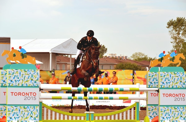 Spc. Nathan Schrimsher of the U.S. Army World Class Athlete Program rides a horse named Taboo en route to earning a berth in the 2016 Olympic Games with a third-place finish in men's Modern Pentathlon at the 2015 Pan American Games on July 19 in Toronto. U.S. Army photo by Tim Hipps, IMCOM Public Affairs #WCAP #RoadToRio #TeamUSA #2015PanAmerican Games