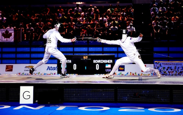Spc. Nathan Schrimsher of the U.S. Army World Class Athlete Program defeats Emmanual Zapata of Argentina in a fencing bonus round bout en route to earning a berth in the 2016 Olympic Games with a third-place finish in men's Modern Pentathlon at the 2015 Pan American Games in Toronto on July 19. U.S. Army photo by Tim Hipps, IMCOM Public Affairs #WCAP #RoadToRio #TeamUSA #2015PanAmerican Games
