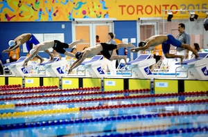 Olympian and Army Sgt. Dennis Bowsher (third from left) starts the 200-meter freestyle swim portion of the men's Modern Pentathlon event July 19 at the 2015 Pan American Games in Toronto. Bowsher finished seventh in swimming with a time of 2 minutes, 6.10 seconds and 10th in Modern Pentathlon with 1,348 points. U.S. Army photo by Tim Hipps, IMCOM Public Affairs