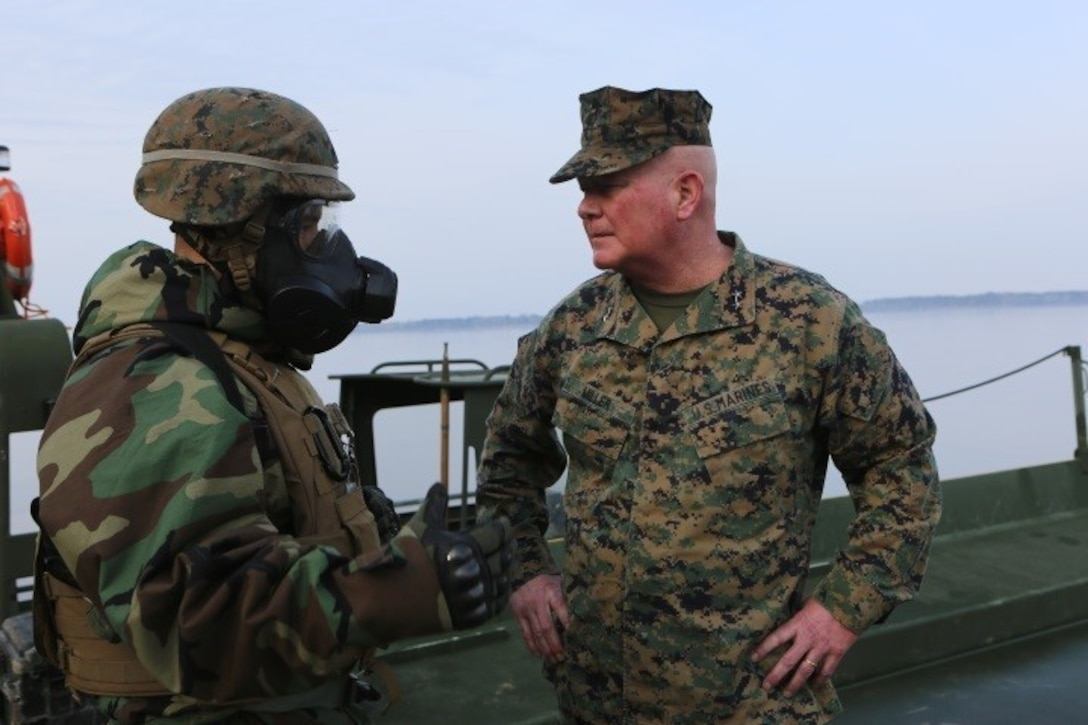 """Maj. Gen. Walter L. Miller (right), commanding general of II Marine Expeditionary Force, speaks to Lt. Col. Robert Bodisch, commanding officer of 2nd Tank Battalion, 2nd Marine Division, about the progression of the Marine Corps Combat Readiness Evaluation, """"Iron Blitz,"""" at Camp Lejeune, N.C., Feb. 22, 2016. Iron Blitz is a weeklong, large scale operation and combat-readiness evaluation used to test the battalion's ability to integrate all aspects of the Marine Air-Ground Task Force and function as a deployment-ready unit. (Marine Corps photo by Cpl. Shannon Kroening)"""