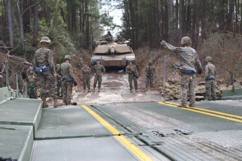Marines with 2nd Tank Battalion, 2nd Marine Division and 8th Engineer Support Battalion, 2nd Marine Logistics Group, traverse the New River from Camp Lejeune, N.C., Feb. 22, 2016. Marines from 8th ESB provided the means for transportation as they loaded all the armor and personnel upon their Seven-Bay Raft systems. The river crossing was part of a weeklong, large-scale exercise known as Iron Blitz. Iron Blitz, a Marine Corps Combat Readiness Evaluation, tested 2nd Tanks in their ability to integrate all aspects of the Marine Air-Ground Task Force and function as a deployment-ready unit. (Marine Corps photo by Cpl. Shannon Kroening)
