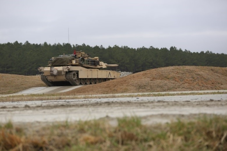 Marines with 2nd Tank Battalion conducted a live-fire exercise at a platoon gunnery tank range for qualification at Camp Lejeune, N.C., Feb. 23, 2016. 2nd Tanks provided direct fire at various targets along the range while moving up and over the berms to improve their reaction times while firing with their M1A1 Abrams tanks. The gunnery range was part of a weeklong, large-scale operation known as Iron Blitz. Iron Blitz, a Marine Corps Combat Readiness Evaluation, tested 2nd Tanks in their ability to integrate all aspects of the Marine Air-Ground Task Force and function as a deployment-ready unit. (Marine Corps photo by Cpl. Shannon Kroening)