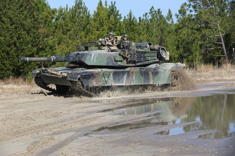 Marines with 2nd Tank Battalion along with 3rd Battalion, 6th Marine Regiment conducted a raid on Combat Town at Camp Lejeune, N.C., Feb. 21, 2016. Marines assigned to 2nd Tanks provided direct fire support while the Marines from 3/6 assaulted the town after receiving word that the town held [notional] opposition forces within. The raid was part of a weeklong, large-scale exercise known as Iron Blitz. Iron Blitz, a Marine Corps Combat Readiness Evaluation, tested 2nd Tanks in their ability to integrate all aspects of the Marine Air-Ground Task Force and function as a deployment-ready unit. (Marine Corps photo by Cpl. Shannon Kroening)