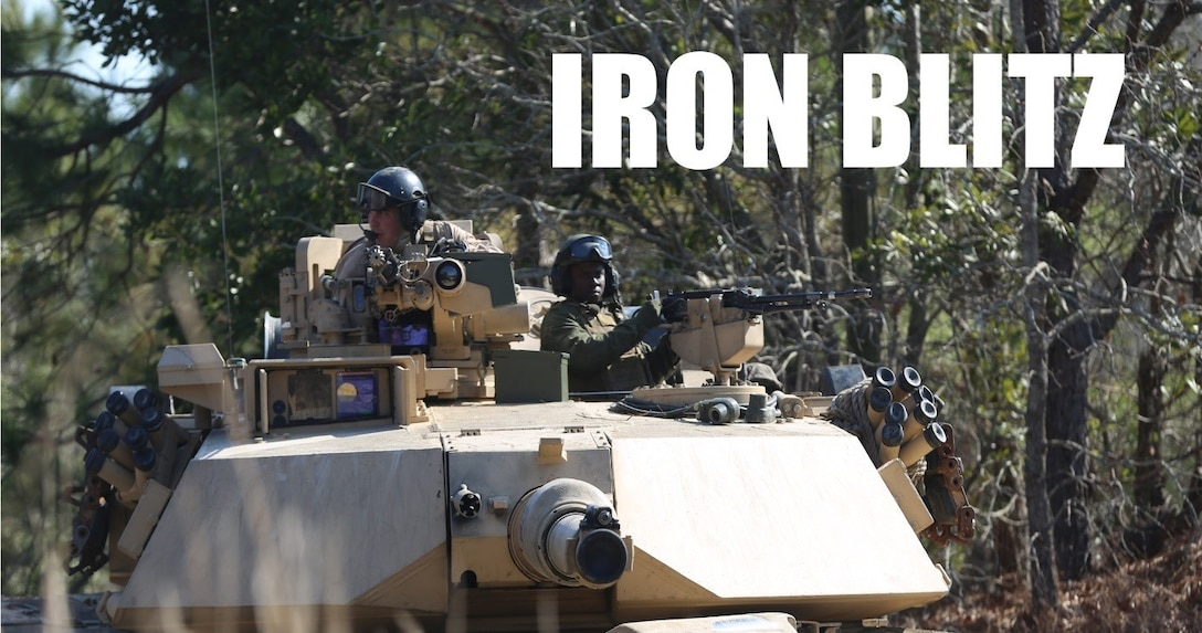 Marines with 2nd Tank Battalion along with 3rd Battalion, 6th Marine Regiment conducted a raid on Combat Town at Camp Lejeune, N.C., Feb. 21, 2016. 2nd Tanks provided direct fire support while the Marines from 3/6 assaulted the town after receiving word that the town held opposition forces within. The raid was part of a weeklong, large-scale operation known as Iron Blitz. Iron Blitz, a Marine Corps Combat Readiness Evaluation, tested 2nd Tanks in their ability to integrate all aspects of the Marine Air-Ground Task Force and function as a deployment-ready unit. (Marine Corps photo by Cpl. Shannon Kroening)