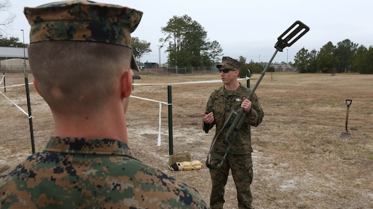 Sgt. Dereck Ford, a technician with Explosive Ordnance Disposal Company, teaches Marines with Combat Logistics Battalion 2 how to power up and recalibrate a metal detector during an improvised explosive device training exercise at Marine Corps Base Camp Lejeune, N.C., Feb. 23, 2016. CLB-2 Marines learned how to recognize signs of an IED and use the detector to identify the type of IED that may be present as they conducted hands-on training in preparation for their upcoming deployment with Special Purpose Marine Air Ground Task Force Crisis Response Africa.