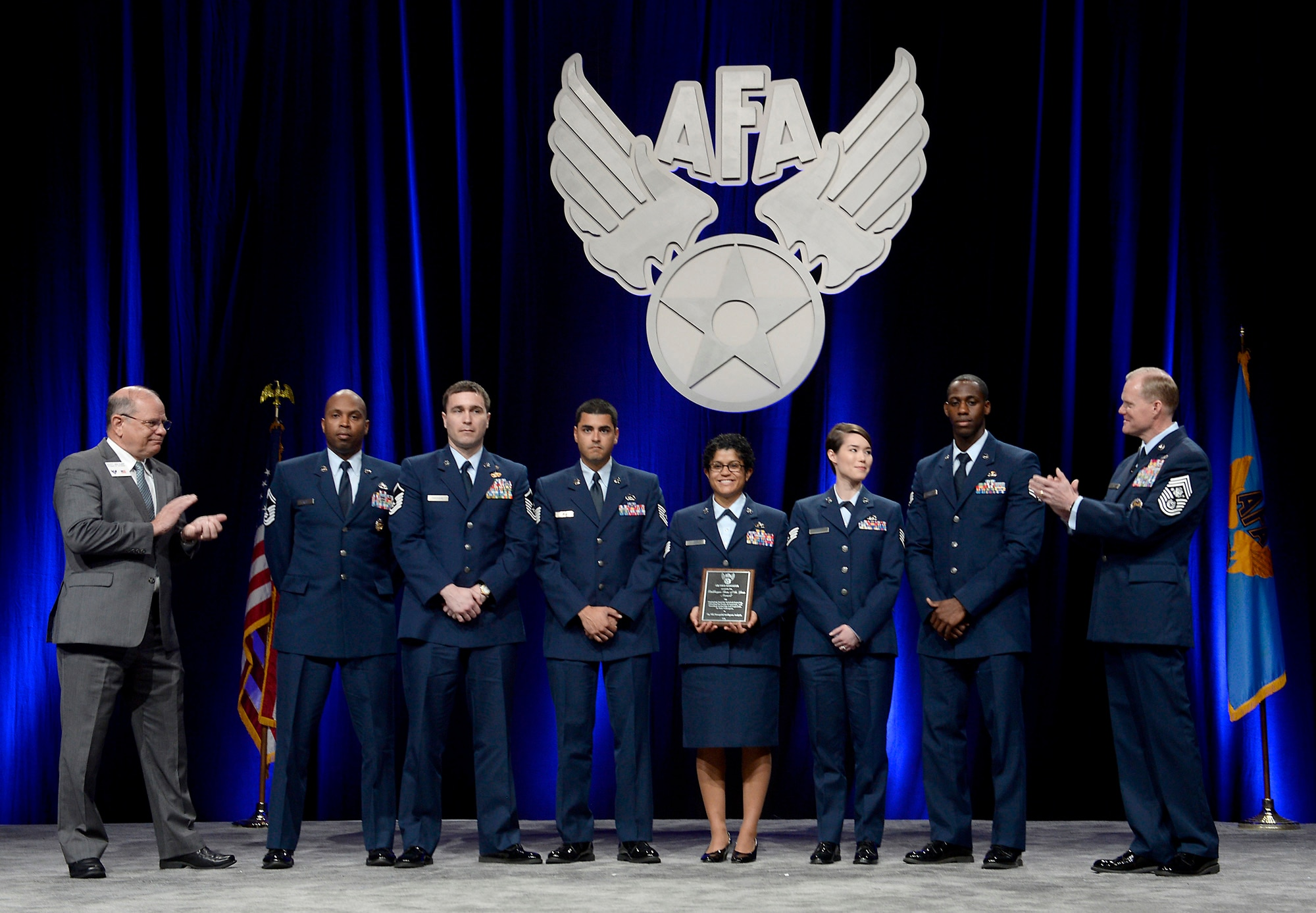 Airmen representing the geospatial intelligence career field are recognized during Chief Master Sgt. of the Air Force James A. Cody's enlisted perspective at the Air Force Association's Air Warfare Symposium in Orlando, Fla., Feb. 25, 2016.  (U.S. Air Force photo/Scott M. Ash)
