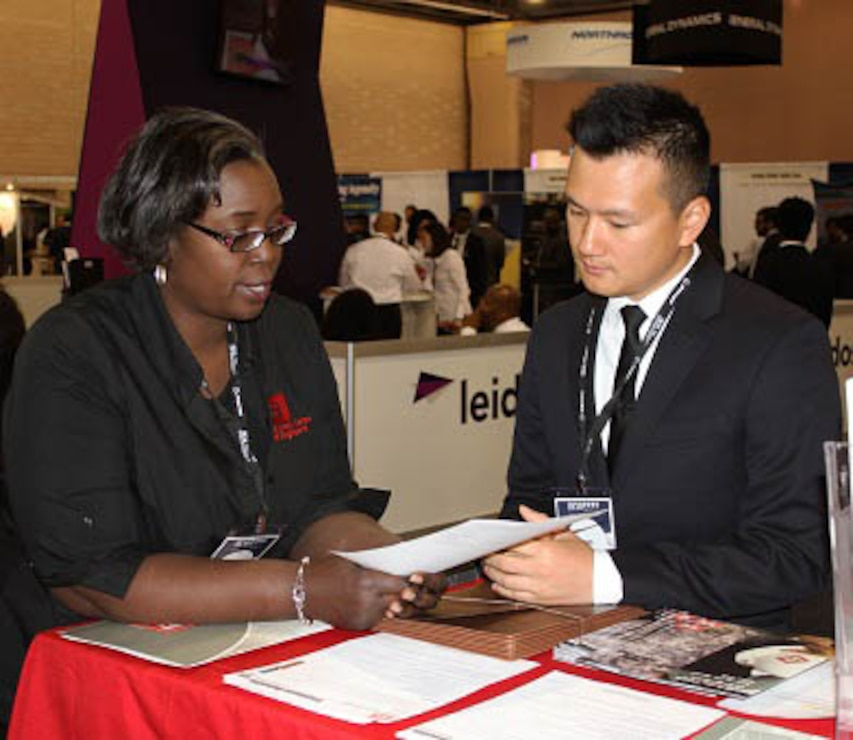 USACE Philadelphia District Engineer Christine Lewis-Coker spoke with a student during the Black Engineer of the Year Award Conference (BEYA) in Philadelphia. USACE employees met with students and young professionals at the event career fair.