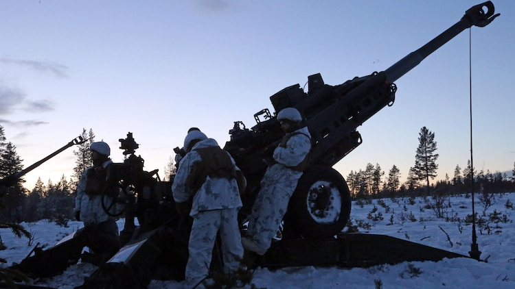 Marines with Combined Arms Company, await the confirmation call of a round impact during a live-fire shoot in Rena, Norway, Feb. 23, 2016, in preparation for Exercise Cold Response 16. The exercise will include 12 NATO allies and partner nations, and approximately 16,000 troops. The Marines will act as support for the infantry battalions during the exercise. The Marines will provide indirect fire support for infantry units during the exercise.
