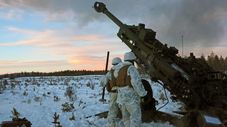 Marines with Combined Arms Company, step back as an M777 Howitzer fires a round during a live-fire shoot in Rena, Norway, Feb. 23, 2016, in preparation for Exercise Cold Response 16. The exercise will include 12 NATO allies and partner nations, and approximately 16,000 troops. The Marines will provide indirect fire support for infantry units during the exercise.