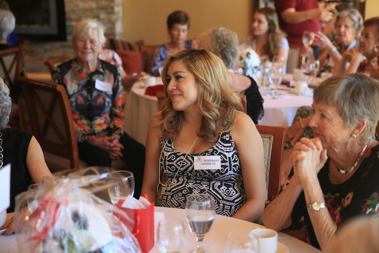 Rosemary Gonzalez, expectant mother, talks with the ladies of the Assistance League of Palm Springs Desert Area during the assistant league's Baby Shower Luncheon for Combat Center expectant mothers at the Oasis Country Club in Palm Desert, Calif., Feb. 16, 2016. (Official Marine Corps Photo by Cpl. Julio McGraw/Released)