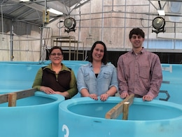 Last summer, researchers at ERDC reached out to the Louisville water quality team to provide samples of different types of HABs to use in research projects. Above, Jennifer Thomason (left), Jade Young and Zac Wolf, the district water quality team, stand behind drums containing HAB samples from Louisville District reservoirs.