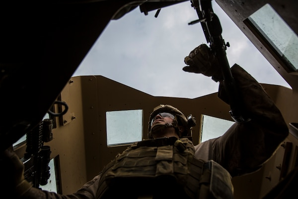U.S. Marine Lance Cpl. Andrew Metler, a mortarman with Bravo Company, 1st Battalion, 7th Marine Regiment, Special Purpose Marine Air Ground Task Force-Crisis Response-Central Command (SPMAGTF-CR-CC), mans the turret gun of a Humvee during a patrol in Al Taqaddum, Iraq, Jan. 1, 2016. U.S. Marines with SPMAGTF-CR-CC are responsible for the force protection of some Combined Joint Task Force – Operation Inherent Resolve bases within the U.S. Central Command area of responsibility. (U.S. Marine Corps Photo by Sgt. Rick Hurtado / Released)