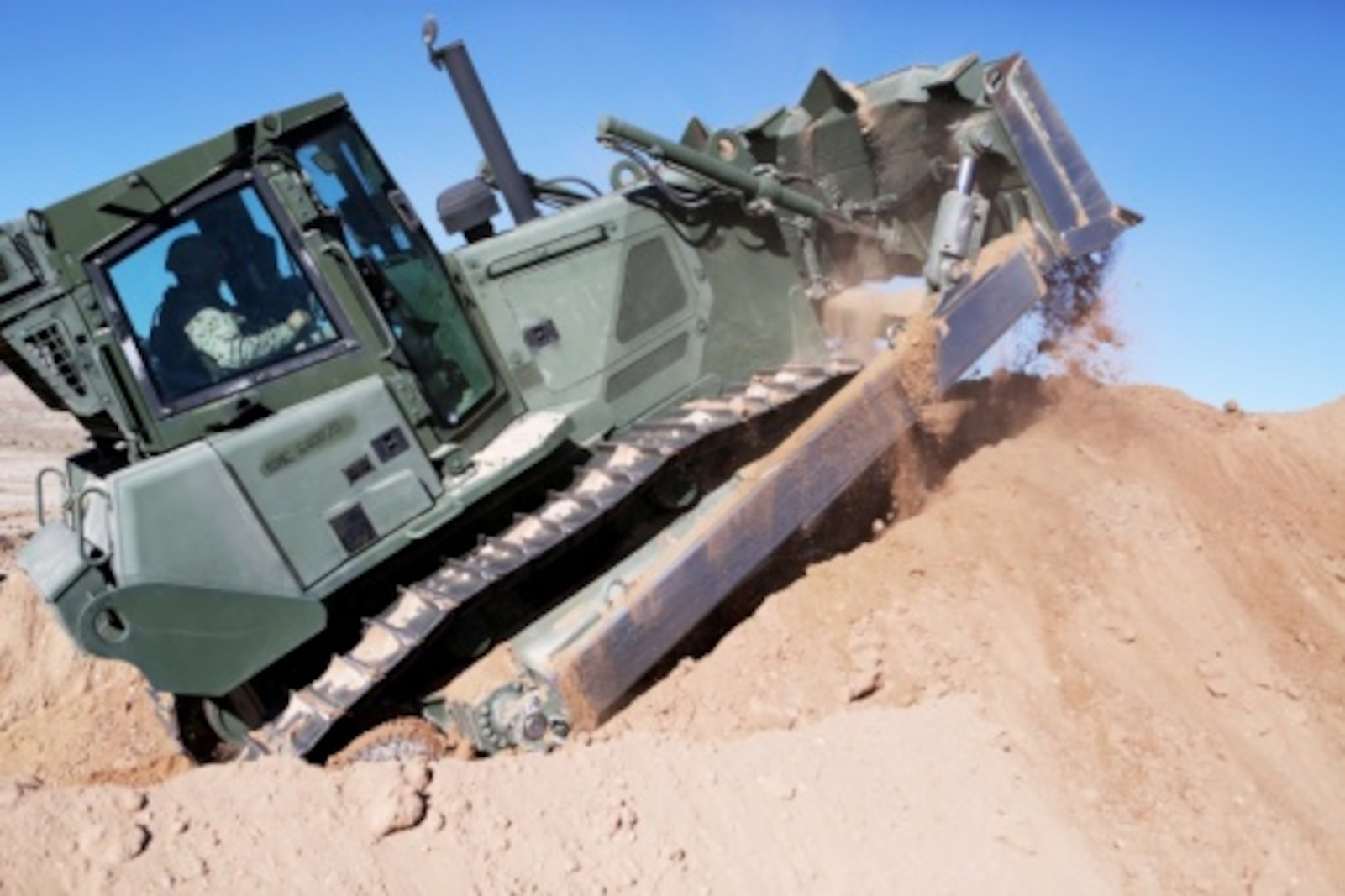 Lance Cpl. Aaron Copley, a heavy equipment operator with Headquarters and Support Company, Combat Logistics Battalion 5, 1st Marine Logistics Group, uses a 626 KR Tram to build a mechanized vehicle fighting position aboard Marine Corps Air Ground Combat Center Twentynine Palms, Calif., Feb. 8, 2016. Marines and Sailors with CLB-5 are participating in Integrated Training Exercise 2-16 in order to prepare their Marines for an upcoming deployment with Special Purpose Marine Air Ground Task Force – Crisis Response – Central Command, as well as increase the proficiency and capabilities of their unit as a whole.