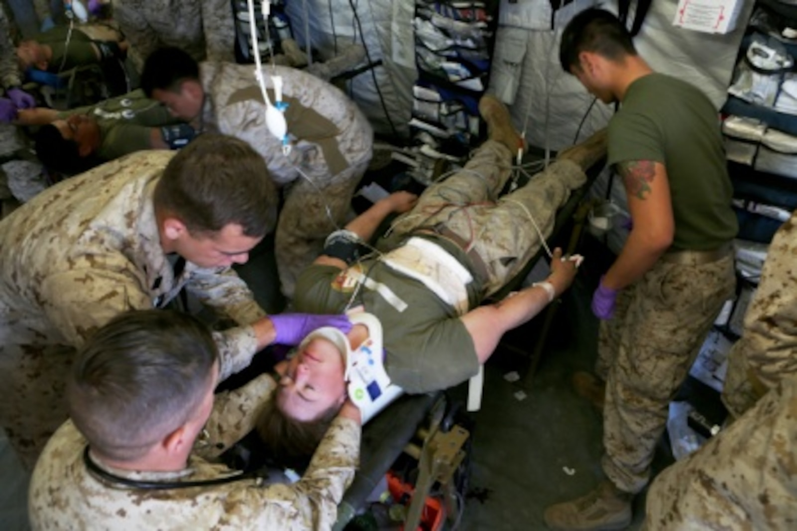 Sailors with Combat Logistics Battalion 5, 1st Marine Logistics Group, work to treat a patient during a mass casualty simulation drill during Integrated Training Exercise 2-16 aboard Marine Corps Air Ground Combat Center Twentynine Palms, Calif., Feb. 10, 2016. The drill began with taking hostile indirect-fire, resulting in multiple casualties with severe wounds. It challenged Marines and Sailors on their ability to react and work together to triage and treat patients accordingly.