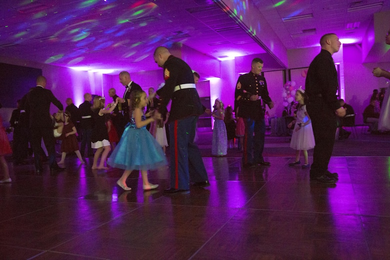 Marines and their daughters dance together during the Father Daughter Dance at Building 1707 Feb. 20, 2016. Marine Corps Community Services hosted the event to provide an opportunity for Marines and sailors to spend time with their daughters. (Official Marine Corps photo by Lance Cpl. Levi Schultz/Released)
