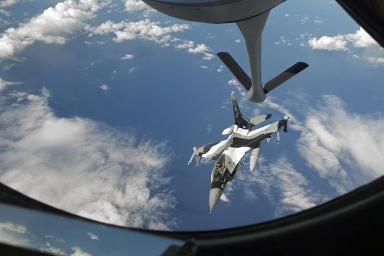 An 18th Aggressor Squadron F-16C Fighting Falcon pulls away from a 909th Air Refueling Squadron KC-135 Stratotanker after aerial refueling during the large force employment of exercise Cope North 16, Feb. 24, 2016, at Andersen Air Force Base, Guam. Through training exercises such as CN16, the U.S., Japan and Australian air forces develop combat capabilities, enhancing air superiority, electronic warfare, air interdiction, tactical airlift and aerial refueling. (U.S. Air Force photo by Staff Sgt. Matthew B. Fredericks/Released)