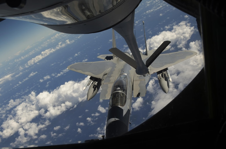 A 44th Fighter Squadron F-15 Eagle connects to a 909th Air Refueling Squadron KC-135 Stratotanker for aerial refueling during the large force employment of exercise Cope North 16, Feb. 24, 2016, at Andersen Air Force Base, Guam. Through training exercises such as CN16, the U.S., Japan and Australian air forces develop combat capabilities, enhancing air superiority, electronic warfare, air interdiction, tactical airlift and aerial refueling. (U.S. Air Force photo by Staff Sgt. Matthew B. Fredericks/Released)