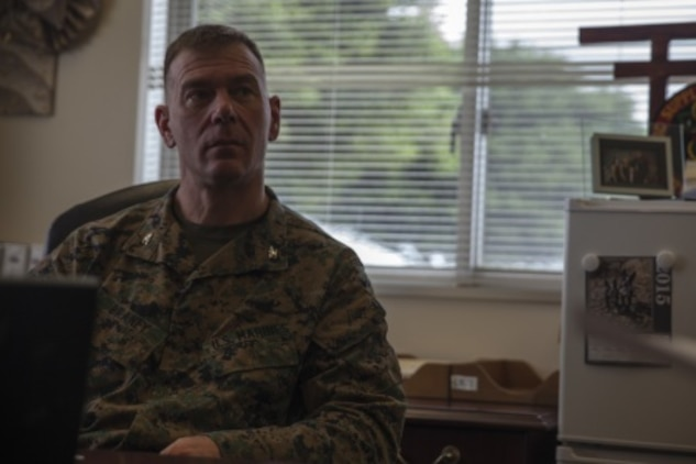 Pictured is Col. Chris Braney preparing for a visit with Japan Ground Self Defense Force logistics officers on Camp Kinser, Feb. 22. The visit is an effort to share the Marine Corps' standard operating procedures in supply and distribution operations with the JGSDF in hopes of enhancing future combined or coalition operations. Braney, from Syracuse, New York, is the regimental commanding officer of Combat Logistics Regiment 35, 3rd Marine Logistics Group, III Marine Expeditionary Force.