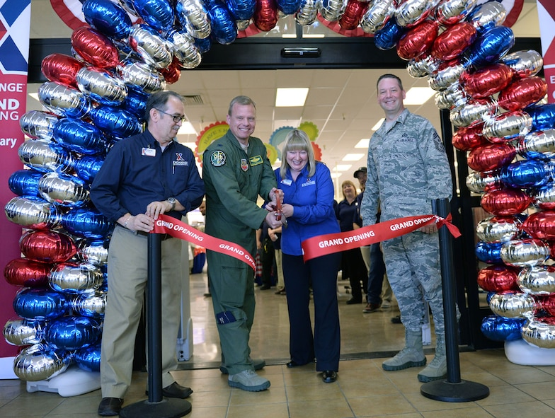 Charlie Marshall (left), base exchange store manager, Col Christopher Stricklin, 9th Reconnaissance Wing vice commander, Mary Omler, BX general manager, and Chief Master Sgt. Randy Kwiatkowski (right), 9th RW command chief, cut the ribbon at Beale Air Force Base Exchange grand reopening Feb. 25, 2016. The approximate $1.9 million project included new flooring, a floor plan to accommodate an expanded product line, new displays and a new central checkout location.