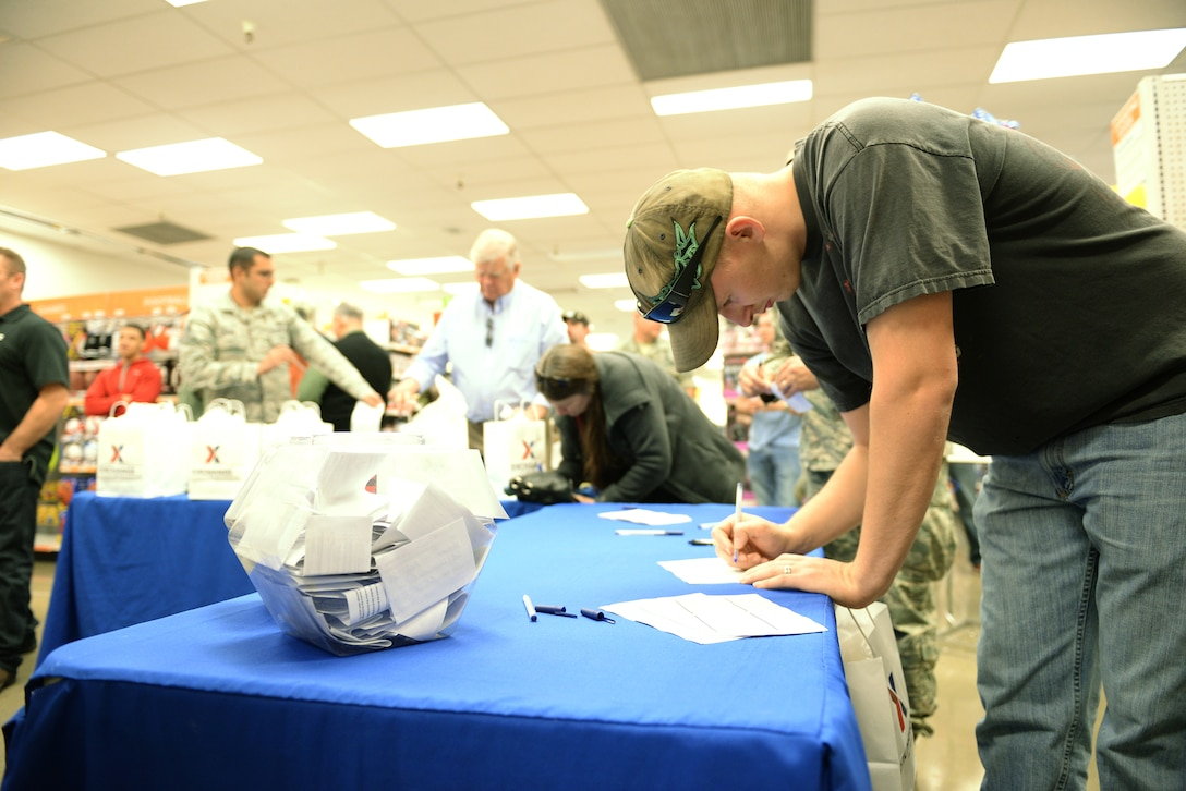 Senior Airman Austin Kauffman, enters a raffle for a free drawing at the newly renovated Base exchange gun shop at Beale Air Force Base, California, Feb 25, 2016. The approximate $1.9 million project included new flooring, a floor plan to accommodate an expanded product line, new displays and a new central checkout location.