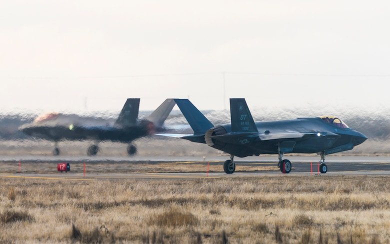 Two F-35As stationed at Edwards Air Force Base, Calif. cross paths at Mountain Home AFB, Idaho, Feb. 11, 2016. The aircrafts team, assigned to the 31st Test Evaluation Squadron, conducted combat simulation tests to determine its efficiency downrange. (U.S. Air Force photo by Airman 1st Class Connor J. Marth/RELEASED)