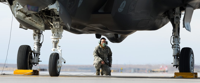 Staff Sgt. Wesley Krueger, 31st Aircraft Maintenance Squadron avionics specialist, inspects an F-35A before takeoff Feb. 16, 2016 at Mountain Home Air Force Base, Idaho. Krueger and his team from Edwards AFB, Calif. visited Mountain Home AFB to determine the aircraft's effectiveness in a deployed environment. (U.S. Air Force photo by Airman 1st Class Connor J. Marth/RELEASED)