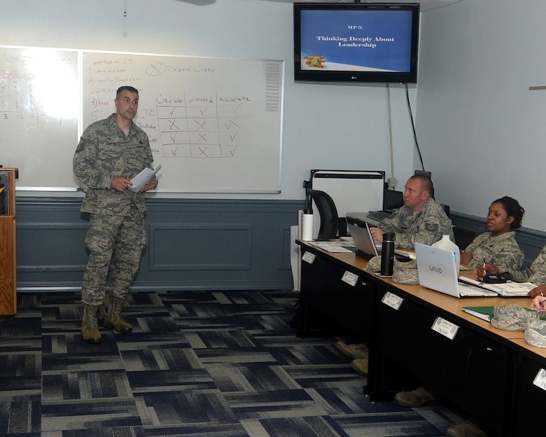 Master Sgt. Rob Compton, Paul W. Airey NCO Academy instructor, teaches a class on leadership and how to give guidance to junior Airmen.  The instructors at NCOA are specifically selected to guide NCOs on the proper leadership path.  (U.S. Air Force photo by Airman 1st Class Cody R. Miller/Released)