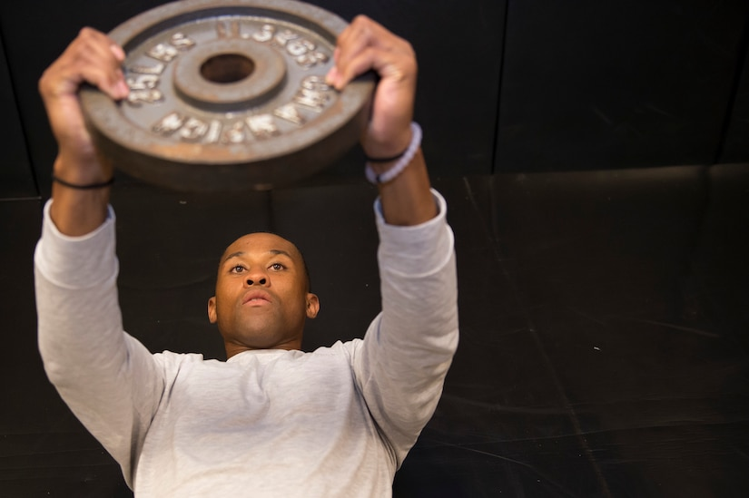 Senior Airman Jarred Alford, a Raven apprentice student,  lifts weights during a three-week Phoenix Raven apprentice course Feb. 17, 2016 at Joint Base Charleston, S.C. Ravens are teams of specially trained security forces personnel dedicated to providing security for AMC aircraft transiting through high terrorist and criminal threat areas. (U.S. Air Force photo/Staff Sgt. Jared Trimarchi)