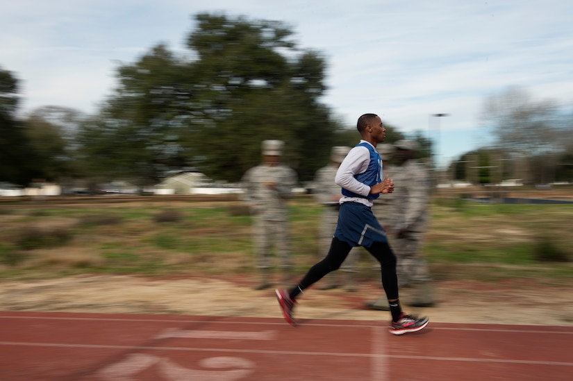 Senior Airman Jarred Alford, a Raven apprentice student, crosses the finish line during a three-week Phoenix Raven apprentice course Feb. 17, 2016 at Joint Base Charleston, S.C. Ravens are teams of specially trained security forces personnel dedicated to providing security for AMC aircraft transiting through high terrorist and criminal threat areas. (U.S. Air Force photo/Staff Sgt. Jared Trimarchi)