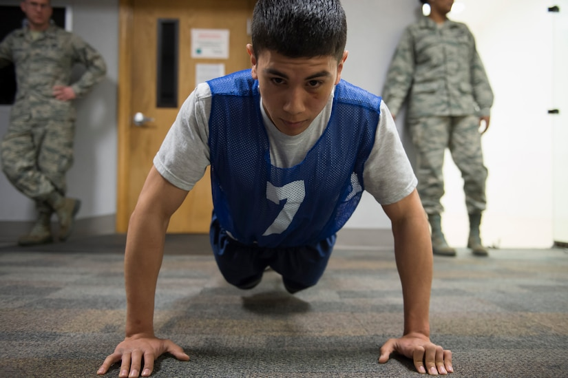 Senior Airman Erik Licon, a Raven apprentice student, does push-ups during a three-week Phoenix Raven apprentice course Feb. 17, 2016 at Joint Base Charleston, S.C. Ravens are teams of specially trained security forces personnel dedicated to providing security for AMC aircraft transiting through high terrorist and criminal threat areas. (U.S. Air Force photo/Staff Sgt. Jared Trimarchi)