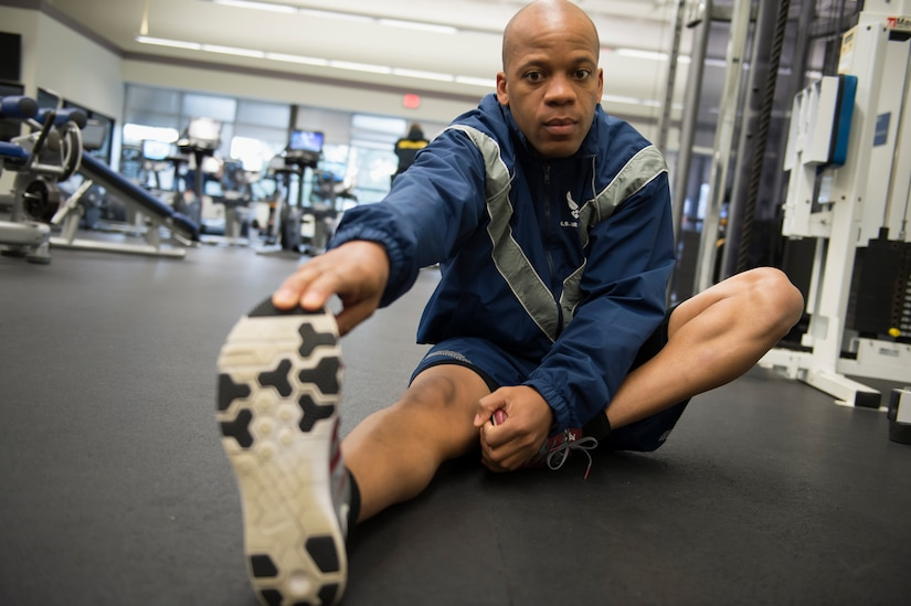 Staff Sgt. Gregory Green, a Raven apprentice student, stretches before taking an Air Force physical training test during a three-week Phoenix Raven apprentice course Feb. 17, 2016 at Joint Base Charleston, S.C. Ravens are teams of specially trained security forces personnel dedicated to providing security for AMC aircraft transiting through high terrorist and criminal threat areas. (U.S. Air Force photo/Staff Sgt. Jared Trimarchi)