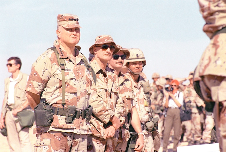 U.S. Army Gen. H. Norman Schwarzkopf (left), U.S. Central Command commander in chief, inspects troops while visiting a base camp during Operation Desert Storm in Saudi Arabia, April 5, 1991. (Courtesy Photo)