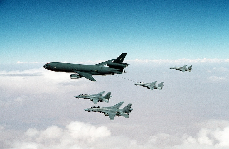 An F-14A Tomcat refuels from a U.S. Air Force KC-10A Extender as other Tomcats fly in formation, during Operation Desert Storm. Squadrons represented by the aircraft are (from foreground) Fighter Squadron 33 (VF-33), Fighter Squadron 84 (VF-84) and Fighter Squadron 14 (VF-14). (Courtesy photo)