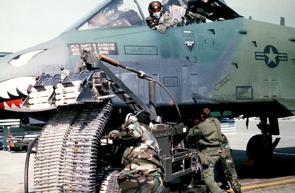 Munitions specialists from the 23rd Tactical Fighter Wing, England Air Force Base, La., load 30 mm rounds of ammunition into an A-10A Thunderbolt II attack aircraft for its GAU-8/A Avenger cannon prior to a sortie in support of Operation Desert Storm. (Courtesy photo)