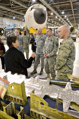 Theresa Farris, 564th Aircraft Maintenance Squadron civilian leader, explains the KC-135 PDM Line to Commanders Summit participants Feb. 19. Pictured are, from left, Air Force Lt. Gen. Lee Levy II, Air Force Sustainment Center commander; Air Force Col. Kenyon Bell, 76th Aircraft Maintenance Group; retired Army Maj. Gen. Myles L. Deering, Oklahoma Secretary of Veterans Affairs; Air Force Col. Clark J. Quinn, 71st Flying Training Wing commander, Vance Air Force Base; Army Maj. Gen. John G. Rossi, Fort Sill commanding general; and Air Force Col. Todd A. Hohn, 97th Air Mobility Wing, Altus Air Force Base.  (Air Force photo by Kelly White/Released)