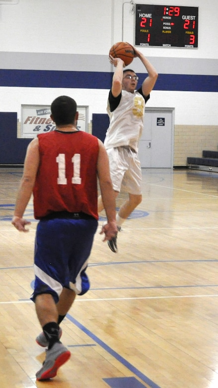 Justin Durso of 552 AMXS sails a high jump shot Feb. 17 with some space away from 507/513/35 Reserves' Brian Watson. AMXS edged Reserves 42-40 in a close game at the Gerrity Fitness Center.   (Air Force photo by John Parker/Released)