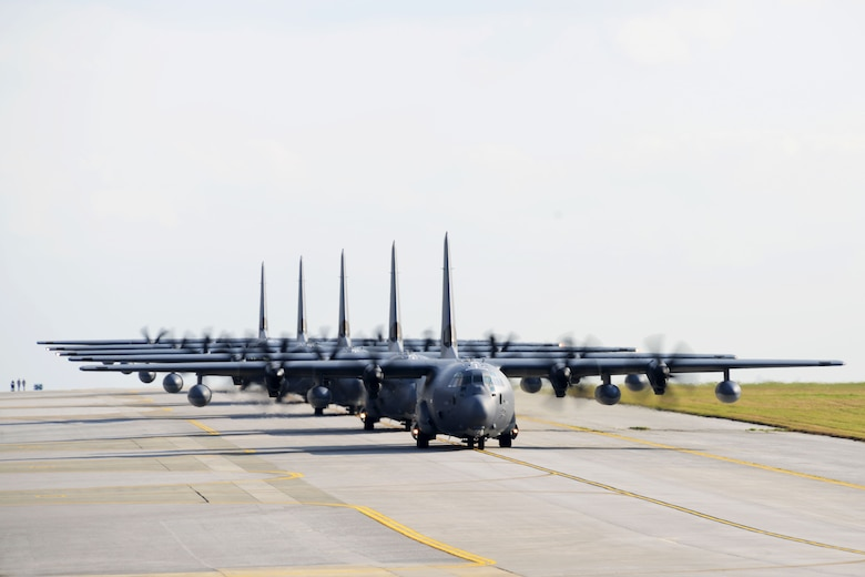 U.S. Air Force MC-130J Command II's assigned to the 17th Special Operations Squadron taxi down the runway Feb. 17, 2016, at Kadena Air Base, Japan. The 17th SOS conducted a unit-wide training exercise which tasked the entire squadron with a quick-reaction, full-force sortie involving a five-ship formation flight, cargo drops, short runway landings and takeoffs, and helicopter air-to-air refueling.   (U.S. Air Force photo by Master Sgt. Kristine Dreyer 353 SOG PA/Released)