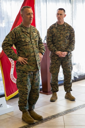 Col. Peter Buck, Left, speaks to Marines after receiving a plaque of recognition from Lt. Col. Jan Durham aboard Marine Corps Air Station Beaufort Feb. 18. The plaque was accepted on behalf of the Provost Marshal's Office who received federal accreditation from Headquarters Marine Corps. HQMC representatives visited Beaufort on several occasions during the accreditation process to evaluate each service section within PMO. Buck is the commanding officer of MCAS Beaufort. Durham is a representative of the Deputy Commandant of Security Plans, Policies, and Operations Security Division.