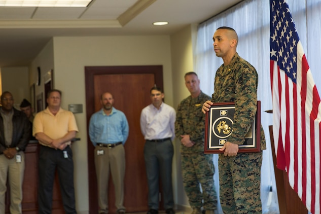 Maj. Eduardo Pinales speaks to Marines after receiving federal accreditation aboard Marine Corps Air Station Beaufort Feb. 18. In order to be eligible for accreditation the Provost Marshal's Office had to meet or exceed the specified curriculum, which is comprised of a series of basic criteria drafted from accreditation programs of larger municipal police forces. Pinales is the Provost Marshal for MCAS Beaufort.