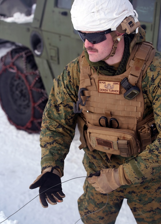 Sgt. Derek Turner, an Explosive Ordnance Disposal technician 2nd EOD Company, Combat Logistics Battalion 252, reels in detonation cord after detonating a controlled explosion in Rena, Norway, Feb. 22, 2016, in preparation for Exercise Cold Response 16. The exercise will include 12 NATO allies and partner nations, and approximately 16,000 troops. Marines will train alongside the Norwegian EOD to see how they operate in order to become more proficient at working with each other in the future.