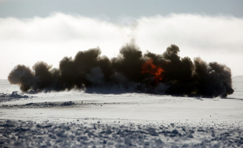 C-4 explodes in Rena, Norway, Feb. 22, 2016. Marines with 2nd Explosive Ordnance Disposal Company, Combat Logistics Battalion 252 tested the effects of various amounts of C-4 in snow in preparation for Exercise Cold Response 2016. The exercise will include 12 NATO allies and partner nations, and approximately 16,000 troops. Marines will train alongside Norwegian EOD specialists to see how they operate in order to become more proficient at working with each other in the future.