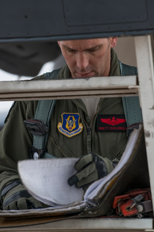 U.S. Air Force Maj. Brett Sailsbury checks the aircraft forms of a B-1 Lancer prior to a mission on Feb. 20, 2016, Dyess Air Force Base, Texas. Sailsbury is a B-1 pilot assigned to the Air Force Reserve Command's 345th Bomb Squadron. (U.S. Air Force photo by Master Sgt. Greg Steele/Released)