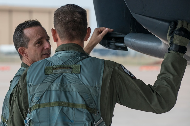 U.S. Air Force Col. Denis Heinz, a weapons systems officer, performs a preflight inspection of a B-1 Lancer prior to a mission on Feb. 20, 2016, Dyess Air Force Base (AFB), Texas. Heinz is Commander of the Air Force Reserve Command's 489th Bomb Group at Dyess, which is assigned under the 307th Bomb Wing at Barksdale AFB, La. (U.S. Air Force photo by Master Sgt. Greg Steele/Released)