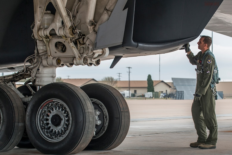 U.S. Air Force Maj. Brett Sailsbury performs a preflight inspection of a B-1 Lancer prior to a mission on Feb. 20, 2016, Dyess Air Force Base (AFB), Texas. Sailsbury is a B-1 pilot assigned to the Air Force Reserve Command's 345th Bomb Squadron, which is assigned under the 489th Bomb Group at Dyess. (U.S. Air Force photo by Master Sgt. Greg Steele/Released)