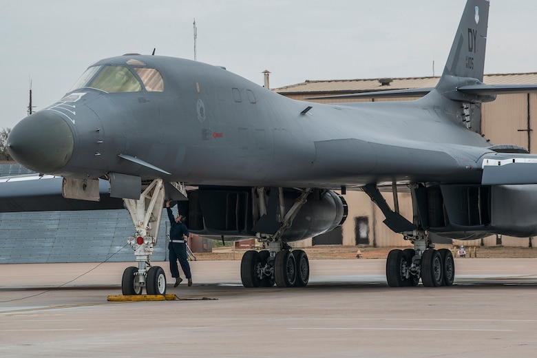 A 489th Maintenance Squadron crew chief jumps to close the cockpit hatch of a 7th Bomb Wing B-1 Lancer prior to a mission on Feb. 20, 2016, Dyess Air Force Base (AFB), Texas. The squadron is assigned to the Air Force Reserve Command's 489th Bomb Group at Dyess, which assigned to the 307th Bomb Wing at Barksdale Air Force Base, La. (U.S. Air Force photo by Master Sgt. Greg Steele/Released)
