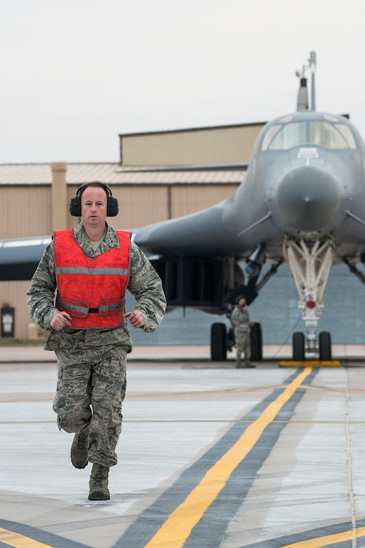 U.S. Air Force Tech. Sgt. Jesse Walters, a crew chief assigned to the 489th Maintenance Squadron, prepares to marshal a 7th Bomb Wing B-1 Lancer from its parking spot in support of a training mission on Feb. 20, 2016, Dyess Air Force Base (AFB), Texas. The 489th MXS is assigned to the Air Force Reserve Command's 489th Bomb Group at Dyess, which assigned to the 307th Bomb Wing at Barksdale Air Force Base, La. (U.S. Air Force photo by Master Sgt. Greg Steele/Released)