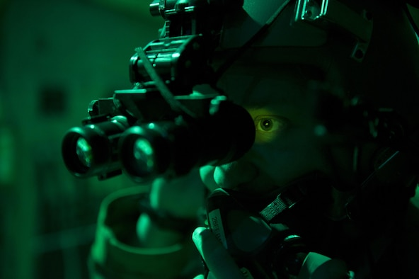 Senior Airman Noah Lindquist, a 774th Expeditionary Airlift Squadron loadmaster, tests his night vision goggles in the back of a C-130J Super Hercules before a sortie at Bagram Airfield, Afghanistan, Feb. 22, 2016. Loadmasters are responsible for calculating aircraft weight, balancing records and cargo manifests, conducting cargo and personnel airdrops, scanning for threats, and troubleshooting in-flight problems. (U.S. Air Force photo/Tech. Sgt. Robert Cloys)