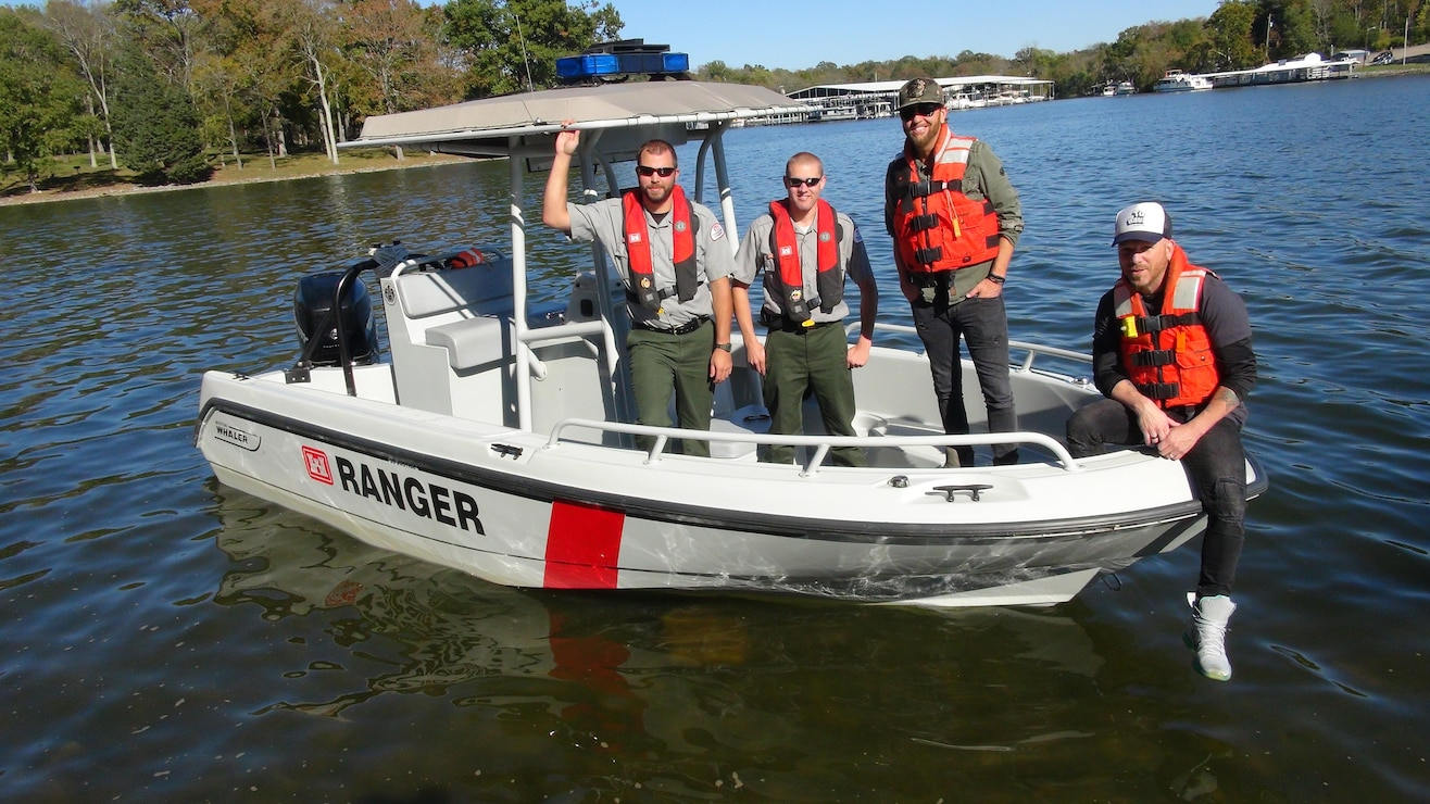 "Preston Brust (second from right) and Chris Lucas (Right) of the country music duo LoCash pose with U.S. Army Corps of Engineers Park Rangers Jacob Albers (Left) and Brent Sewell at Old Hickory Lake in Hendersonville, Tenn, Oct. 19, 2015.  The group filmed a water safety PSA that features LoCash's hit song ""I Love This Life,"" which is currently moving up the country music charts. It is being used to support the USACE National Water Safety Campaign ""Life Jackets Worn, Nobody Mourns."""
