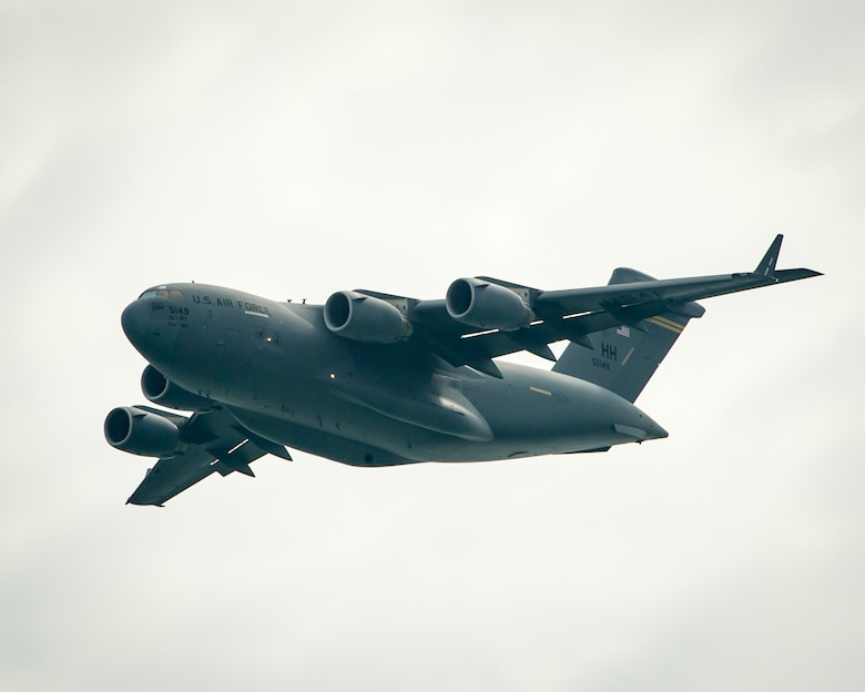 A C-17 Globemaster III from the 15th Wing at Joint Base Pearl Harbor-Hickam, Hawaii, practices its aerial demonstration routine prior to the Singapore International Airshow at Changi International Airport, Singapore, Feb. 15, 2016. Through participation in air shows and regional events, the U.S. demonstrates its commitment to the security of the Indo-Asia-Pacific region, promotes equipment interoperability, displays the flexible combat capabilities of the U.S. military, and creates lasting relationships with international audiences. (U.S. Air Force photo/Capt. Raymond Geoffroy)